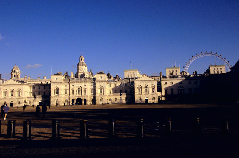 Horse Guards & the London Eye. The Horse Guards building and the London Eye wheel in London stock images