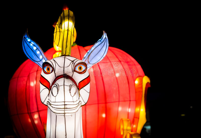 A horse head lantern on a bright red background. London, United Kingdom - February 07, 2016: Magical Lantern Festival at Chiswick House And Gardens. A horse head royalty free stock image