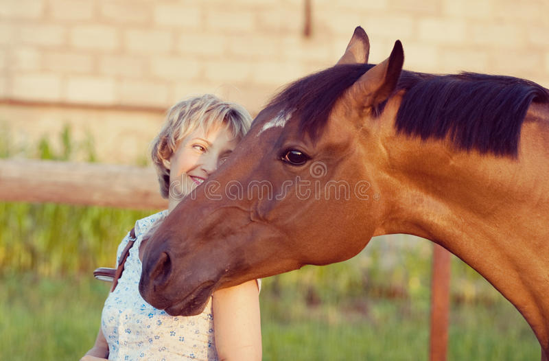 Horse head on womans shoulder royalty free stock image