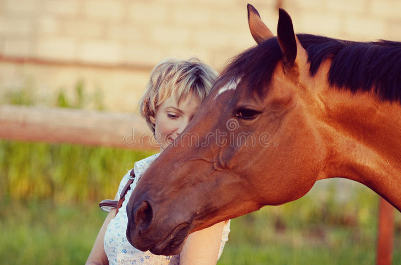 Horse head on womans shoulder royalty free stock photography