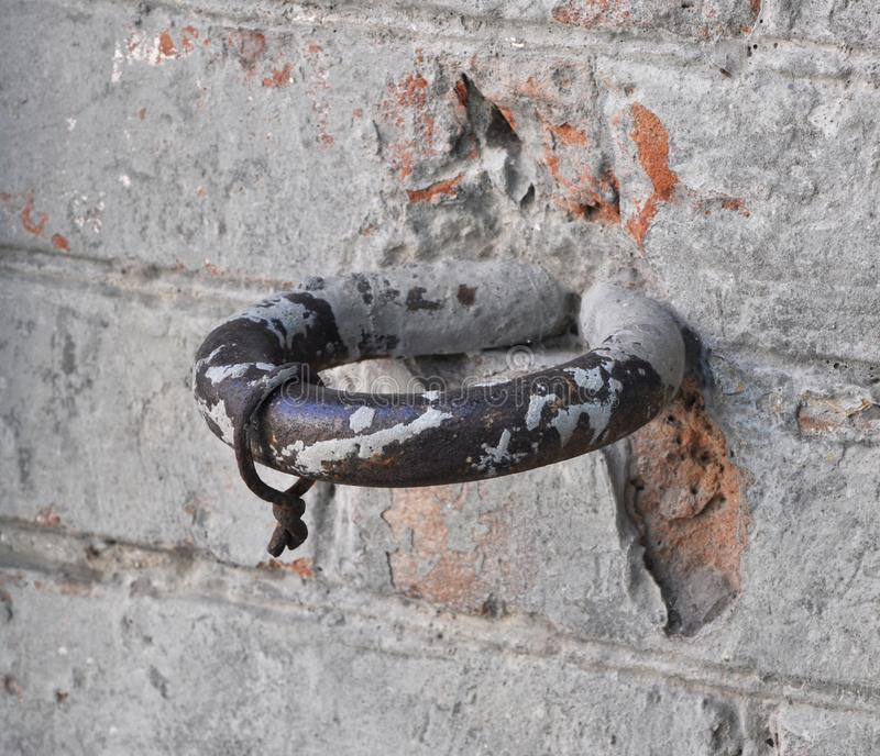 Horse hitching ring on a roughly plastered wall stock images