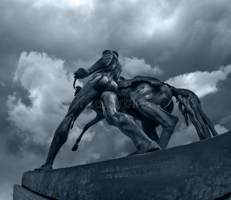 Horse holding man sculpture of Anichkov Bridge in Saint Petersburg stock photography