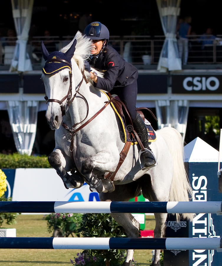 Horse jumping competition. BARCELONA, SPAIN - SEPTEMBER 25: Giulia Martinengo from Italy in action during the CSIO 100th International Jumping Competition, on stock image
