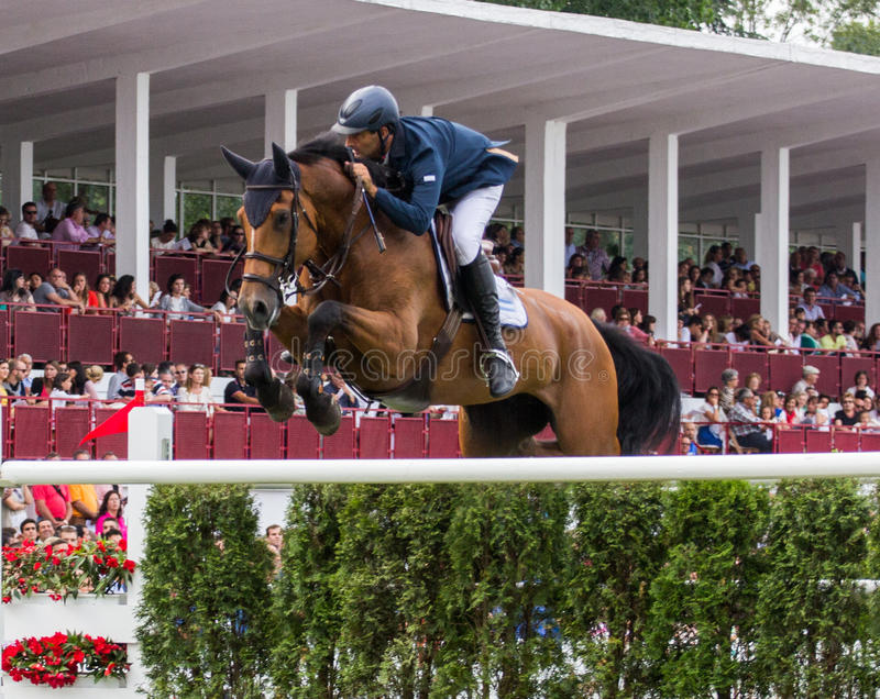 Horse jumping competition. GIJON, SPAIN Aug 2014: Participants in the International Jumping Competition CSIO 5 Gijon 2014 Spain, from July 31 to August 4 stock photo