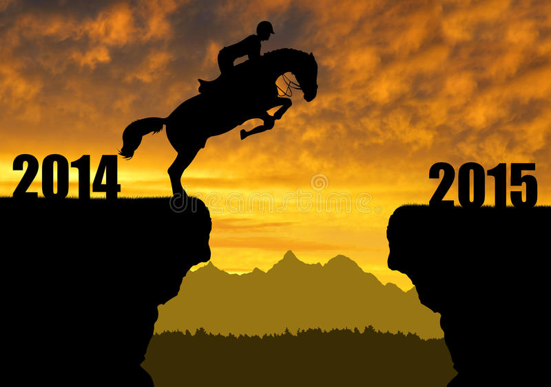 Horse jumping into the New Year 2015. The rider on the horse jumping into the New Year 2015 royalty free stock image