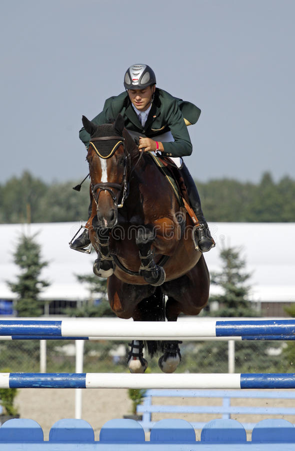 Horse jumping show. Champion of Poland of seniors Msciwoj Kiecon on the Urbane horse stock photo