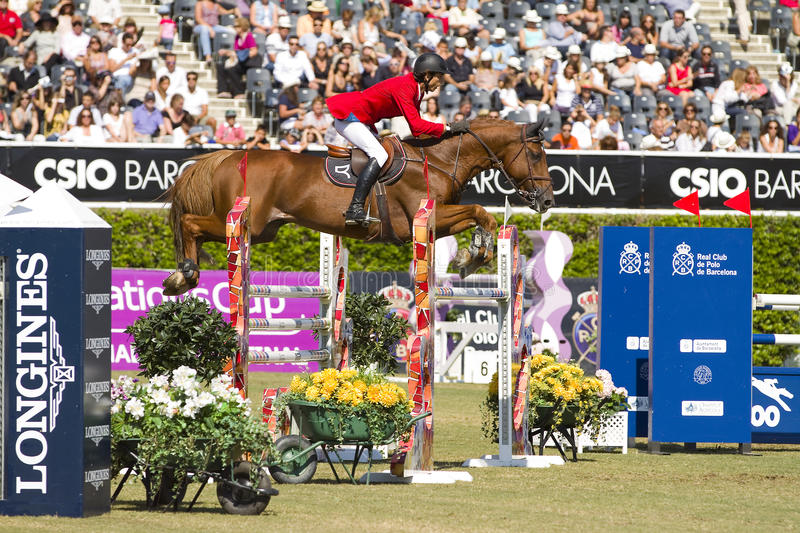 Horse jumping - Tomas Couve. Tomas Couve from Chile rides Golddigger at the 100th CSIO event at the Real Club de Polo Barcelona, on September 25, 2011, in royalty free stock images
