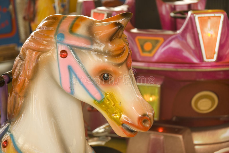 Horse in the merry-go-round. Merry go round with the head of a horse royalty free stock photos