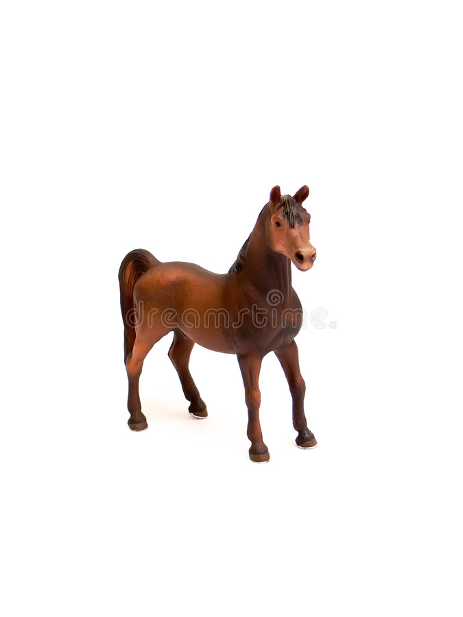 Horse- plastic toy. Close up of the brown horse - plastic toy isolated on white background royalty free stock photo