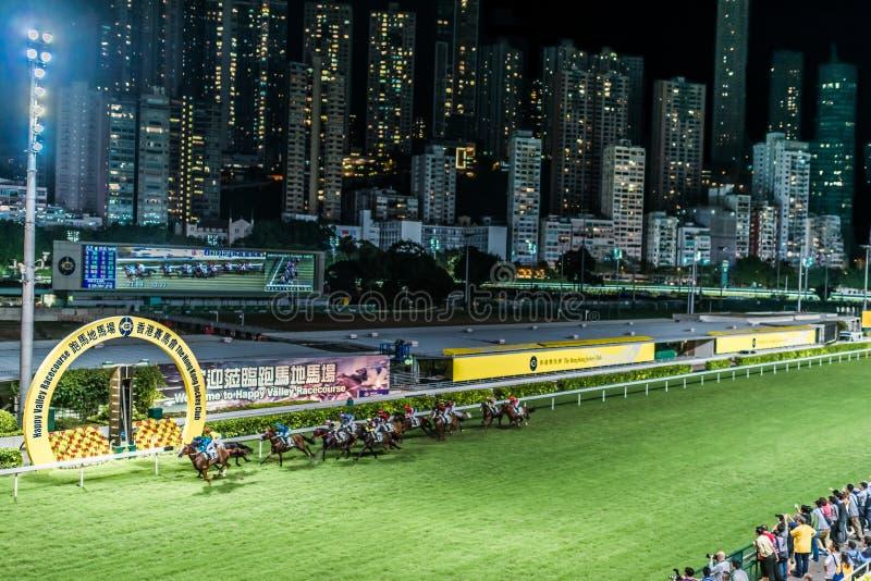 Horse race Happy Valley racecourse Hong Kong. Happy Valley, Hong Kong, China- June 5, 2014: horse race at Happy Valley racecourse royalty free stock images