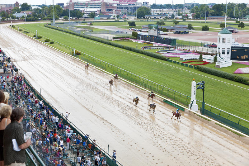 Horse races at Churchill Downs. Louisville, KY – June 18: Stephen Foster Day at Churchill Downs horse race track June 18, 2011 in Louisville, KY. Finish royalty free stock image