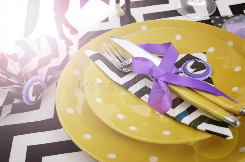 Horse racing carnival event luncheon table place setting with lens flare. royalty free stock image