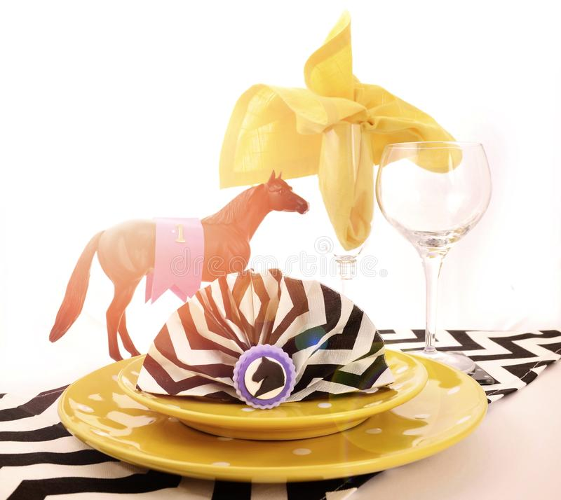 Horse racing carnival event luncheon table place setting with lens flare. stock images