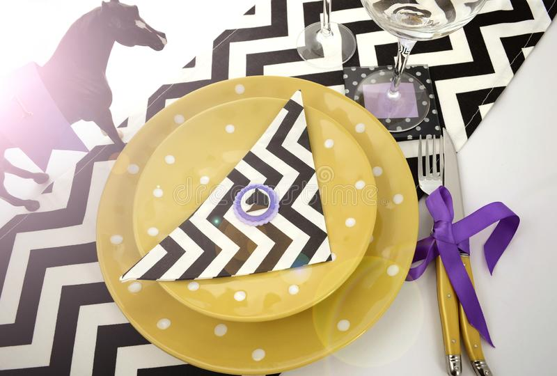 Horse racing carnival event luncheon table place setting with lens flare. royalty free stock photo