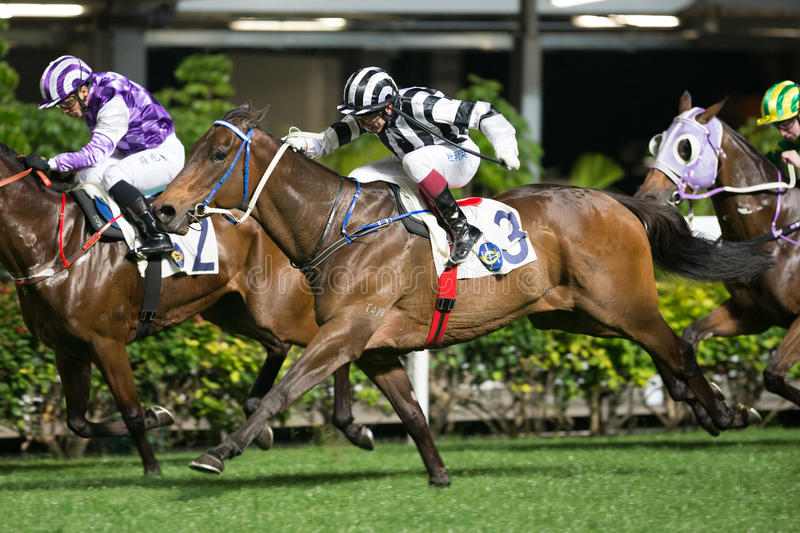 Horse Racing in Hong Kong - Happy Valley Racecourse. Jockey Olivier Doleuze no.3 riding Invisible winning the Race 1 Paterson Handicapat the Happy Valley stock image