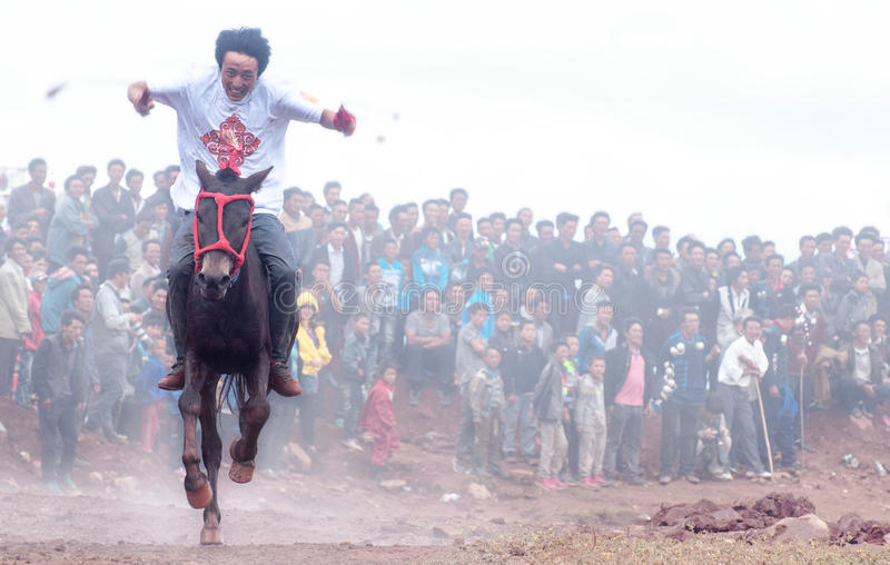 Horse Racing. Torch festival is the traditional festival of the Yi nationality people which lived at southwest area of China. This is the horse racing in the stock photography