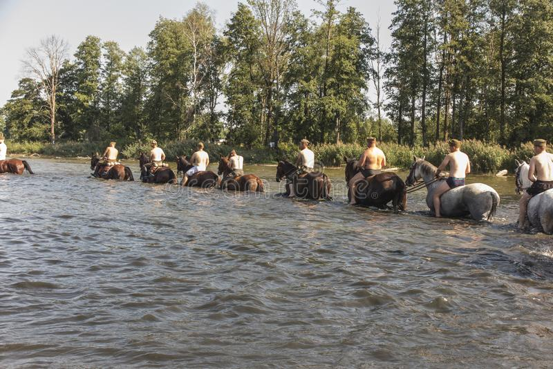 Horse Rally along the Battle Trail of the 3rd Silesian Uhlans Regiment, swimming the horses of the Volunteer Squadron in the. Kalety, Zielona, Poland August 31 stock photography