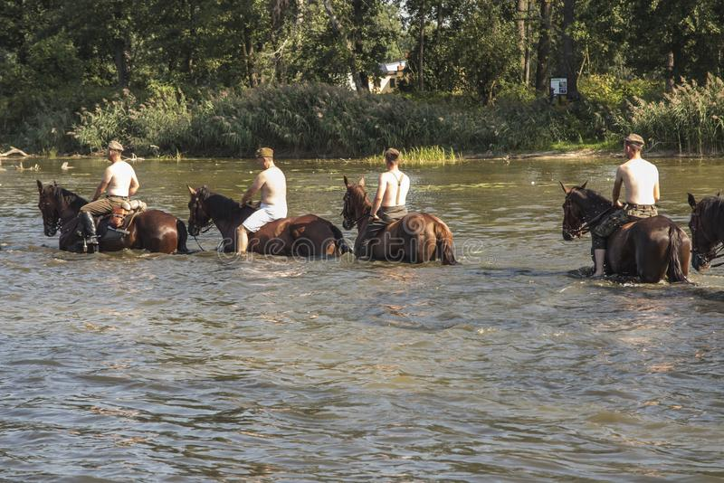 Horse Rally along the Battle Trail of the 3rd Silesian Uhlans Regiment, swimming the horses of the Volunteer Squadron in the. Kalety, Zielona, Poland August 31 royalty free stock image