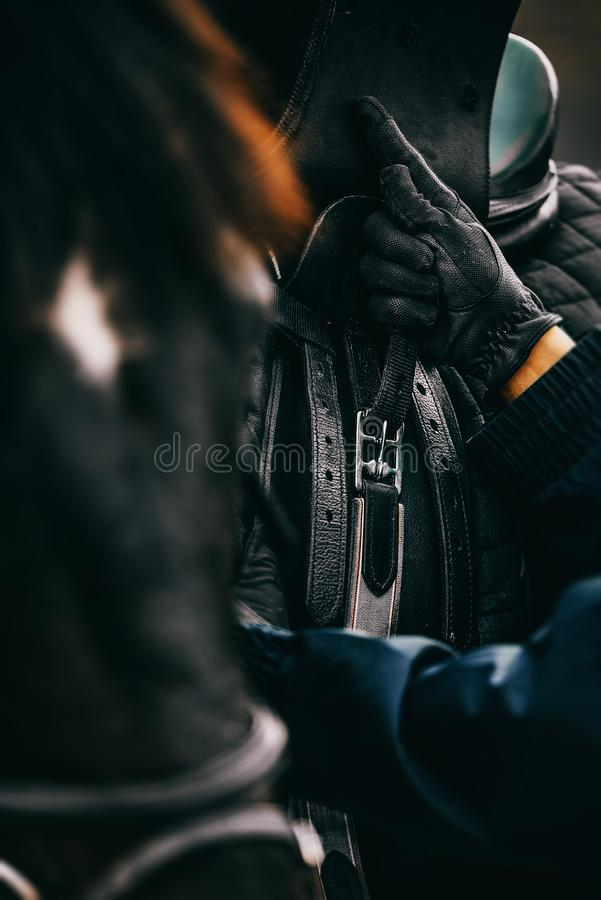 Horse rider in action detail shot. Cinematic grading royalty free stock photography