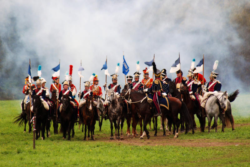 Horse riders at Borodino battle historical reenactment in Russia. BORODINO, MOSCOW REGION - SEPTEMBER 04, 2016: Reenactors dressed as Napoleonic war soldiers stock image