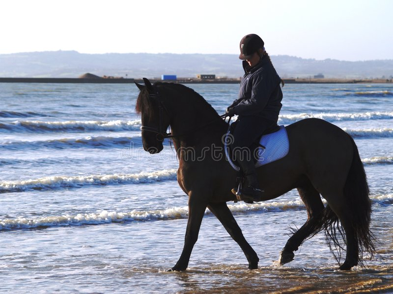 Horse Riding on the beach stock photo