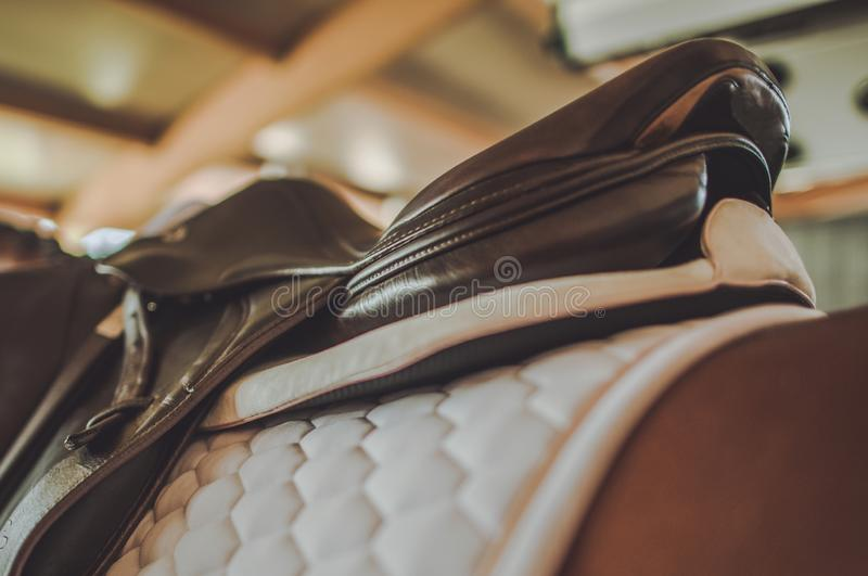 Horse Riding Equipment. Elegant Saddle and White Pad. Equestrian Facility royalty free stock image