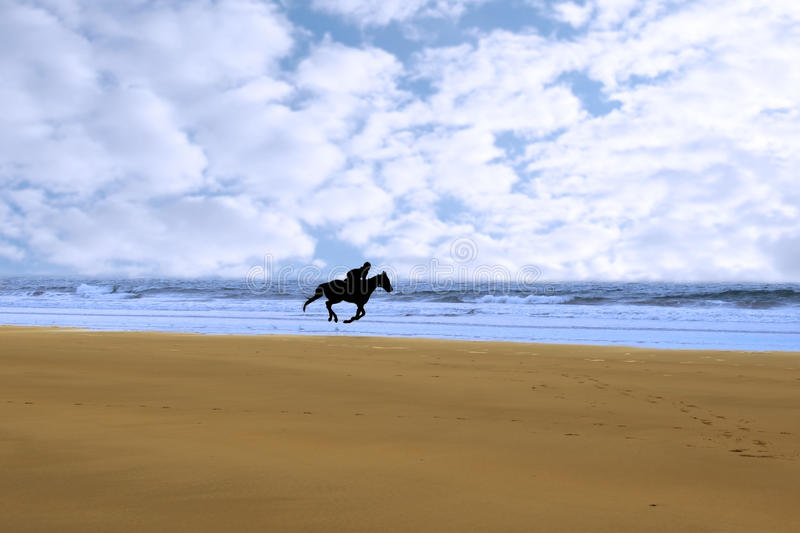 Horse riding on kerry shore. Horse riding on ballybunions beach shore on irelands west coast royalty free stock photo