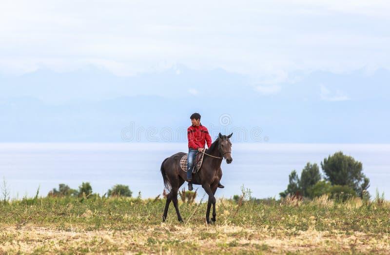 Horse Riding in Kyrgyzstan stock image