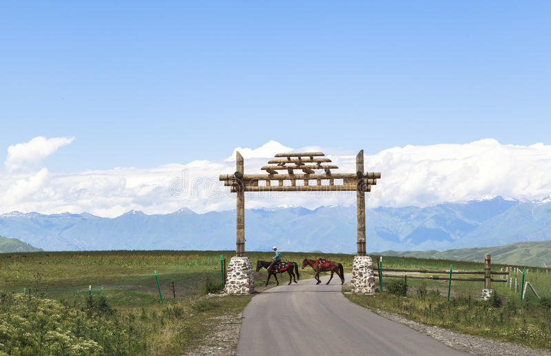 Horse Riding in Meadow of Xinjiang, China stock image
