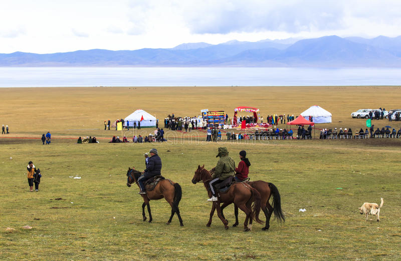 Horse Riding in Song kul Lake in Kyrgyzstan royalty free stock image