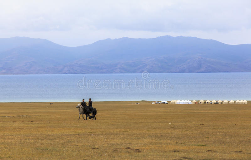 Horse Riding in Song kul Lake in Kyrgyzstan stock images