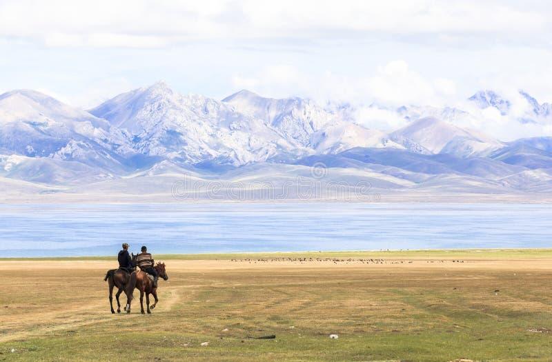 Horse Riding at Song Kul Lake in Kyrgyzstan royalty free stock photos