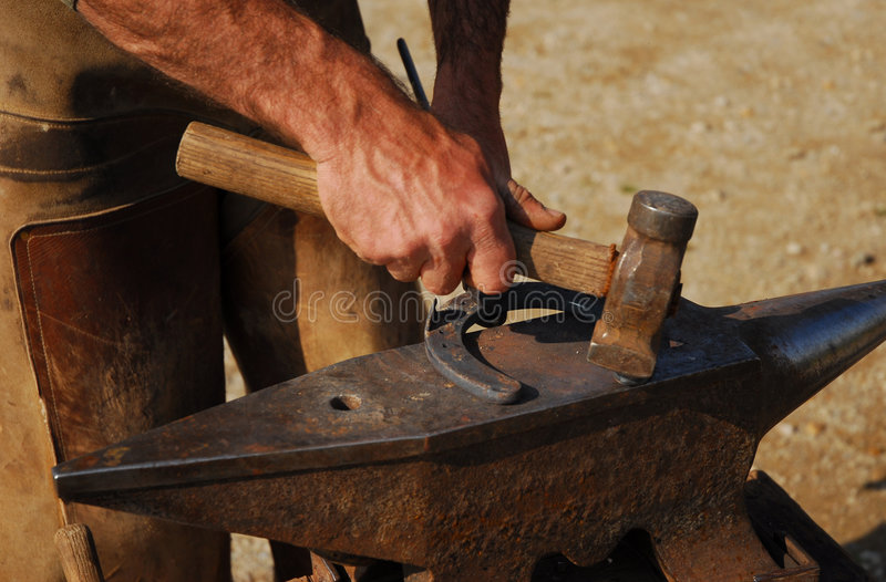 Horse's hoof 2. Horse's hoof and a man: beautiful black horse shoes stock images
