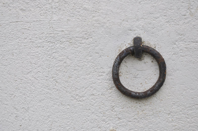 Horse's ring. A ring used for tie horses on a farm's wall stock photography