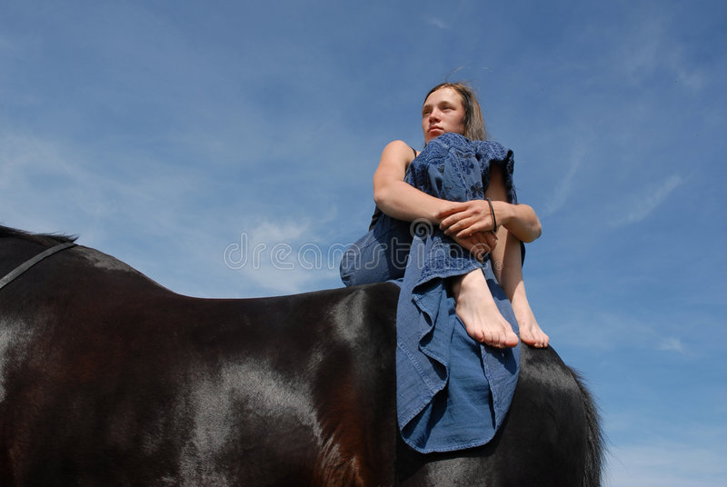 Horse And Sad Teen Stock Image