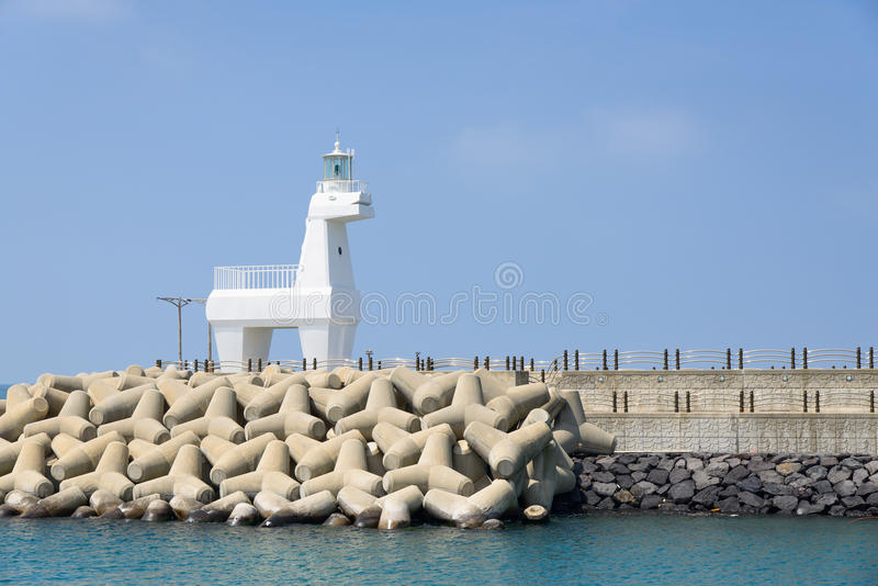 Horse shaped lighthouse. On a breakwater with tetrapod near the Iho Teu beach in Jeju Island, Korea royalty free stock photo