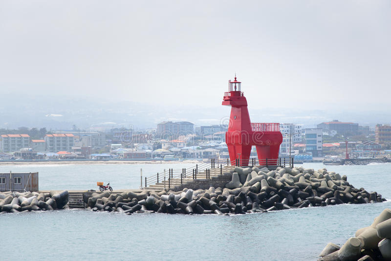 Horse shaped lighthouse. On a breakwater with tetrapod near the Iho Teu beach in Jeju Island, Korea stock photography