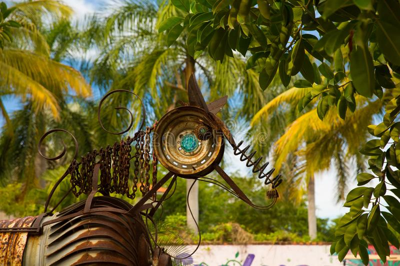 Upcycled Horse sculpture in San Pancho. Horse statue made from recycled metal parts palm trees in San Pancho, Nayarit, Mexico royalty free stock images