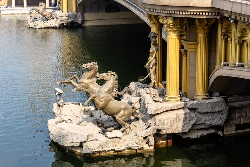 Horse statues below a European style bridge crossing the Haihe River in Tianjin. Horse statues below a European style bridge crossing the Haihe River in the city royalty free stock photography
