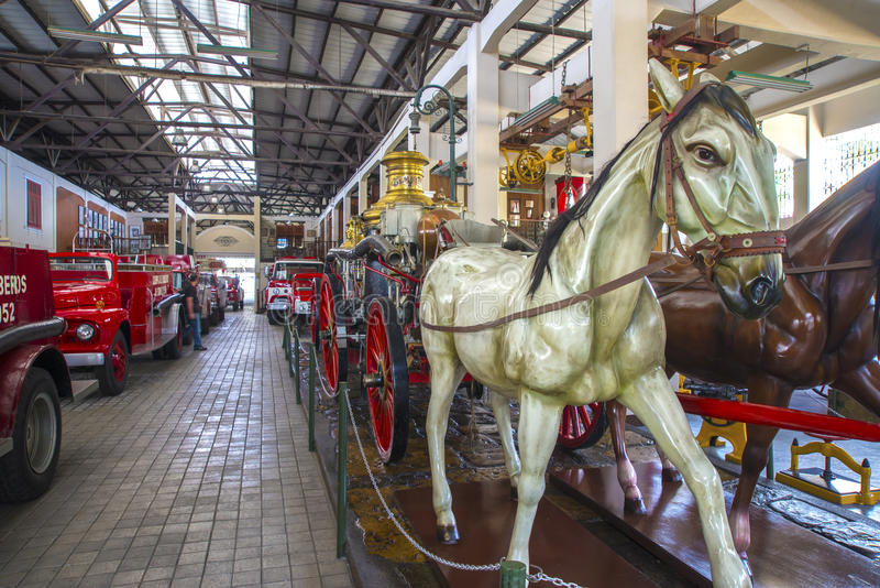 Horse statues and firetrucks royalty free stock photos