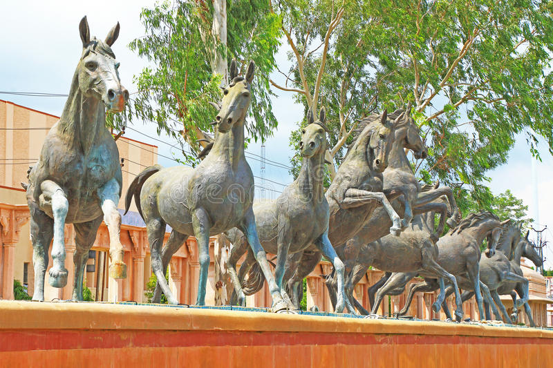 Horse statues kota palace and grounds india. A row of horse statues on pedestal kota india stock photography