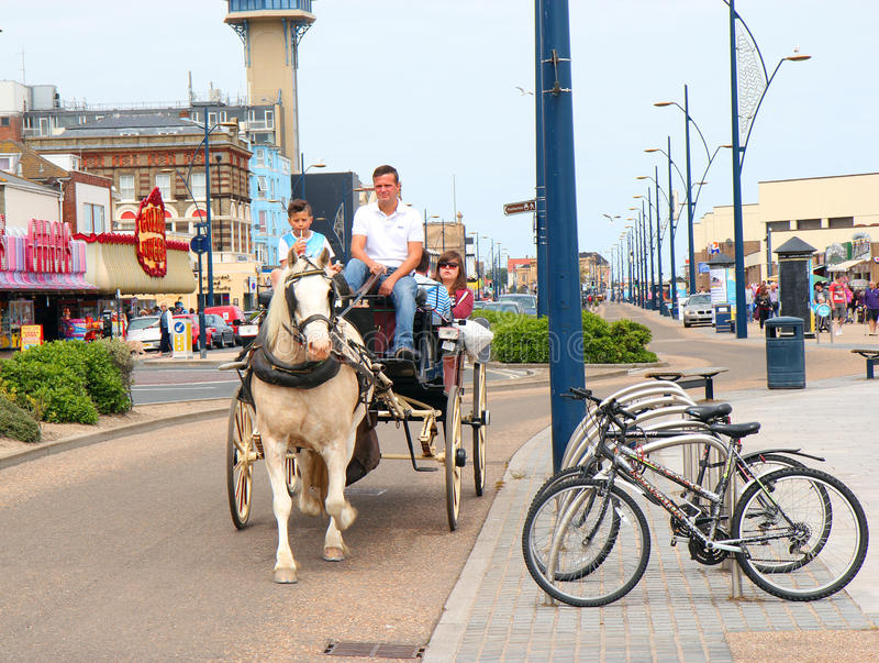 Horse taxi Great Yarmouth, United Kingdom. A horse drawn taxi carrying passengers on the seafront at Great Yarmouth, United kingdom stock image
