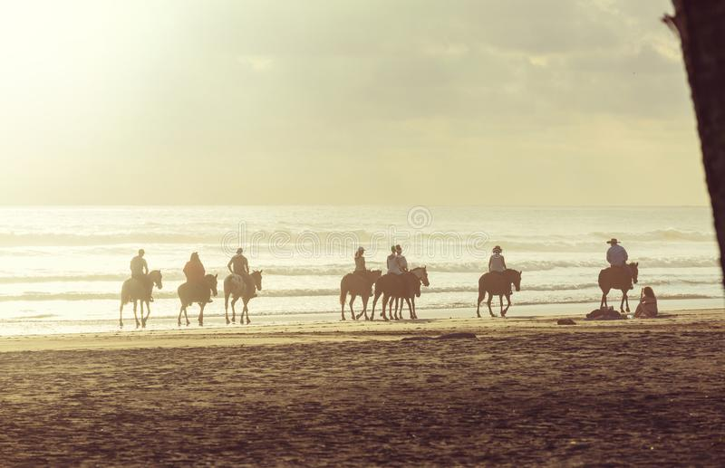 Horse tour. People horseback riding on shore in Costa Rica, Central America stock images