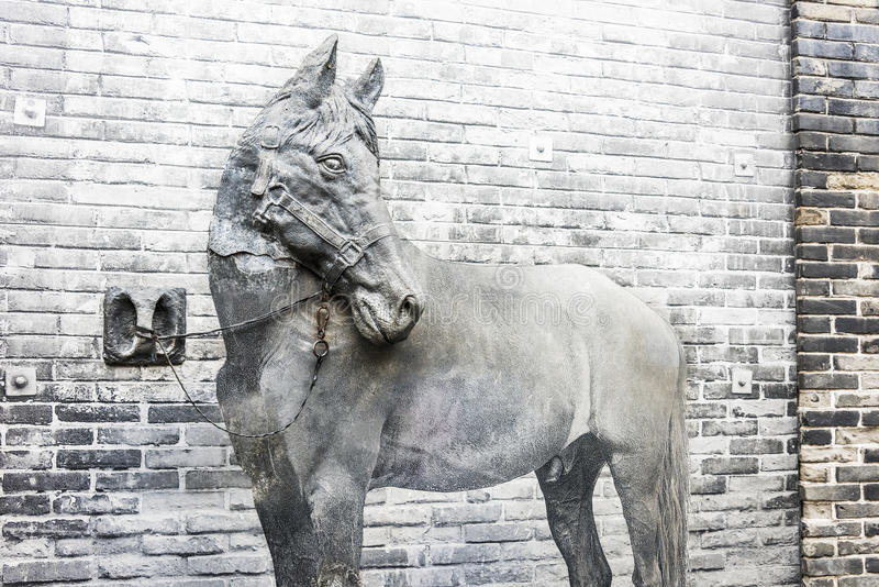 The horse and wall stock image