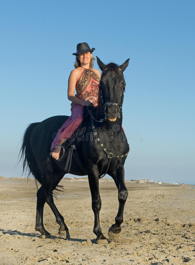 Horse woman on the beach royalty free stock photo
