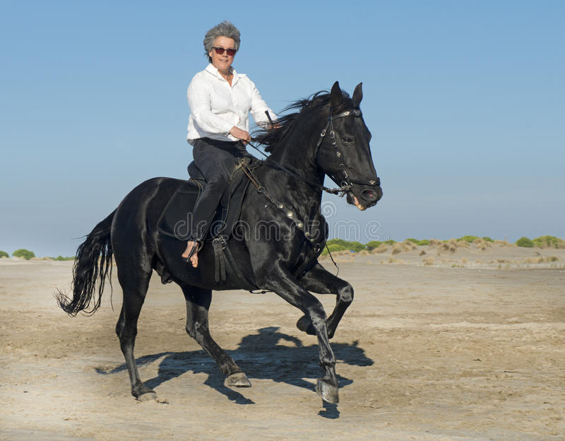 Horse woman galloping stock photos