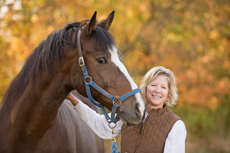 Horse and Woman Smiling royalty free stock photo