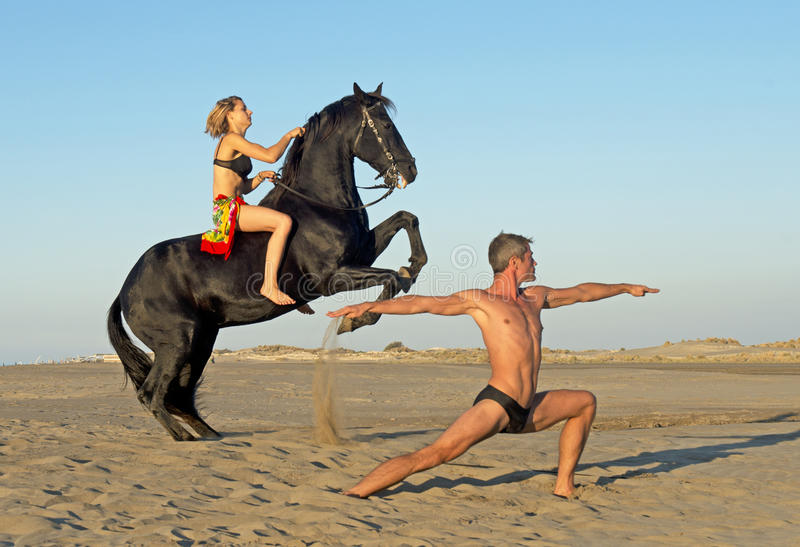 Horse woman and yoga man stock photography