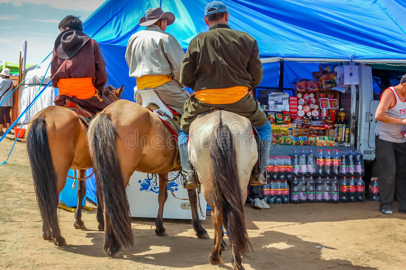 Horseback riders in traditional deel, Nadaam horse race, Mongolia royalty free stock images