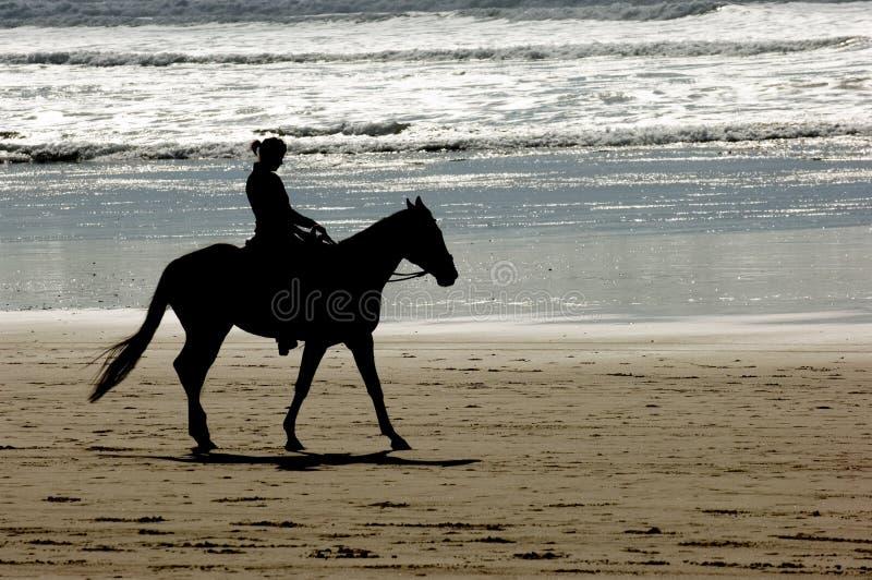 Horseback riding. Cannon beach, Oregon coast, USA royalty free stock image